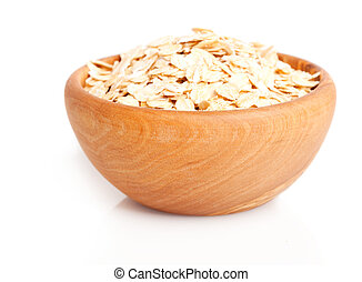 oat flakes in the wooden bowl.