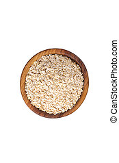 Oat-flakes in wooden bowl. Isolated. Top view.