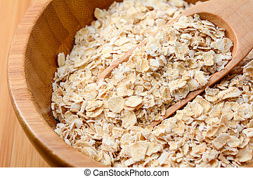 oat flakes in wooden bowl