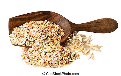 oat flakes in wooden scoop