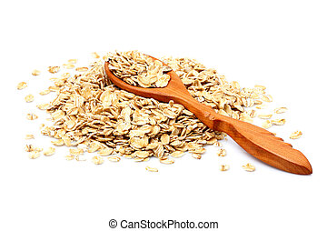 Oat flakes in wooden spoon isolated.