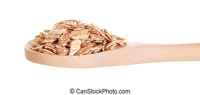 Oat flakes in wooden spoon isolated on white