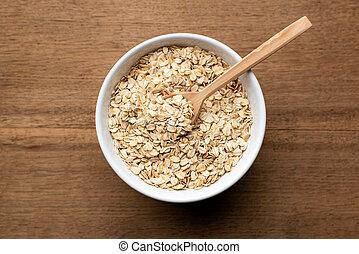 Oat flakes, oatmeal in bowl