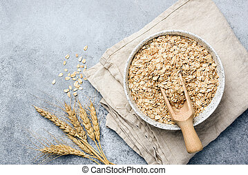 Oat flakes, oats or rolled oats in bowl