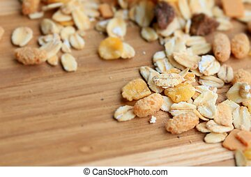 Oat flakes on a wooden background