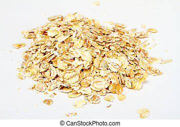 Oat flakes on white background