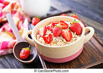 oat flakes with strawberry in the bowl