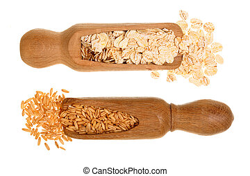 oat grains and oat flakes in wooden scoop isolated on white background. Top view. Flat lay