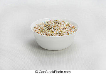 oat meal close up - Bowl of oats porridge isolated on a ...
