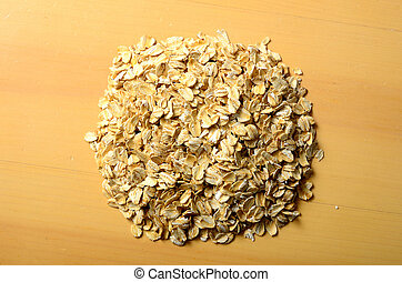 oat meal - heap of rolled oats