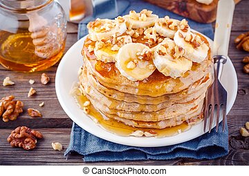 Oat pancakes with banana, walnuts and honey