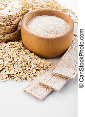 Various dietary oat products on white background