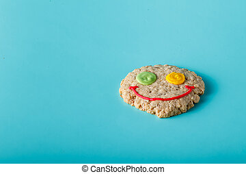 Oat smile cookies on aquamarine background
