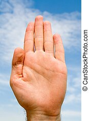 oath. hand gesture with blue sky at background
