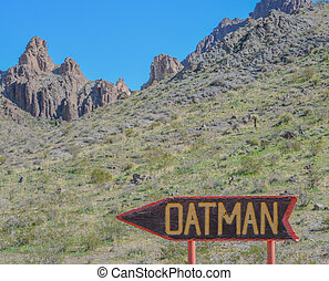 Oatman Sign, a Wild West Ghost Town on U.S. Route 66 in the Black Mountain Range of the Sonoran Desert, Arizona USA