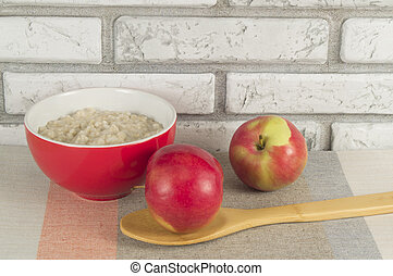 Oatmeal and apples for Breakfast. The concept of healthy nutrition