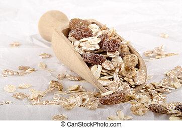 oatmeal and raisins on a shovel
