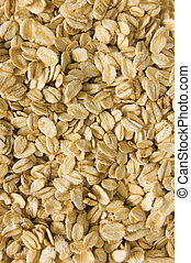 Oatmeal background, rolled raw oats macro closeup vertical -...