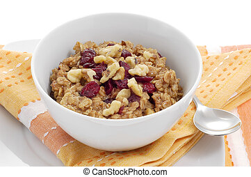 Oatmeal - Bowl of oatmeal with dried fruit and nuts.