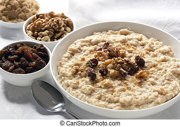 Oatmeal - Bowl of oatmeal with raisins, walnuts, and brown ...