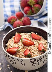 Oatmeal breakfast with strawberries