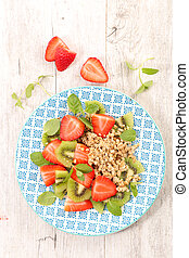 oatmeal, cereal with strawberry and kiwi