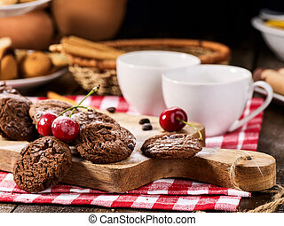 Oatmeal chocolate cookies with coffee grains and cherry. Sun...