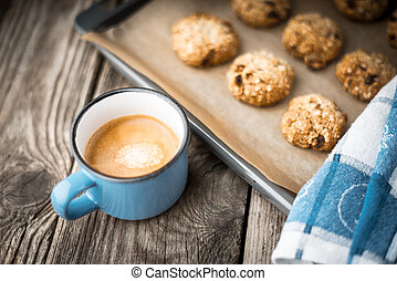 Oatmeal cookies and coffee cup on a wooden table