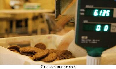 Oatmeal cookies move along the conveyor belt. - Oatmeal...