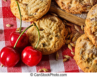Oatmeal cookies snack and cherry breakfast close up - ...