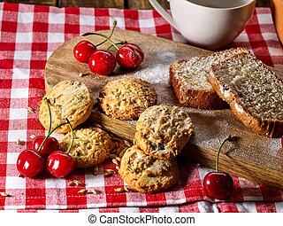 Oatmeal cookies snack and cherry cupcake breakfast - Oatmeal...