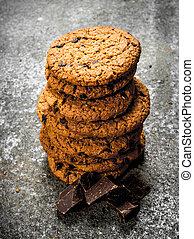 Oatmeal cookies with chunks of chocolate.