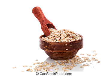 Oatmeal flakes. Healthy eating. - Oatmeal flakes in wooden...