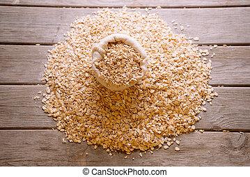 Oatmeal flakes in a sack