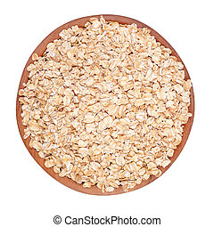 Oatmeal flakes in a wooden bowl on a white background