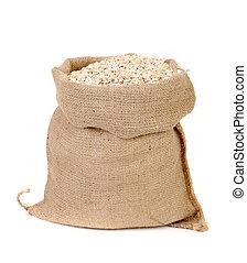 Oatmeal flakes in sack.