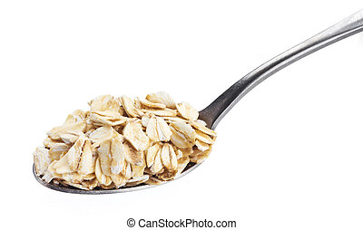 Oatmeal. Oat flakes in spoon isolated on white background