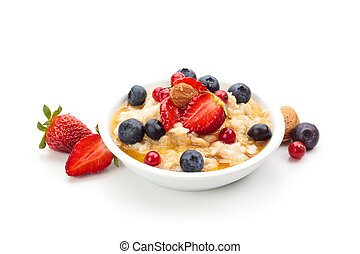 Oatmeal. - Oatmeal and fresh fruits isolated on white ...