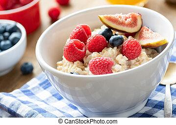 Oatmeal porridge bowl with fresh berries