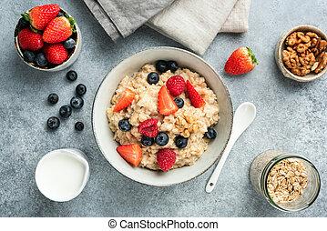 Oatmeal porridge bowl with summer berries