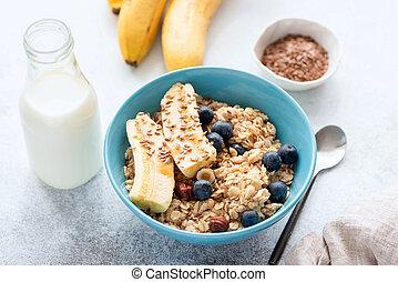 Oatmeal porridge with banana, blueberry, nuts