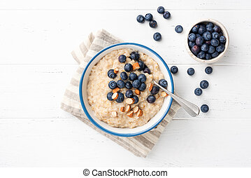 Oatmeal Porridge With Blueberries, Almonds In Bowl