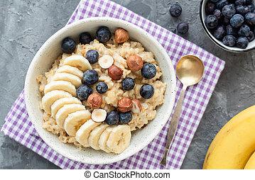Oatmeal porridge with blueberry, banana and hazelnut