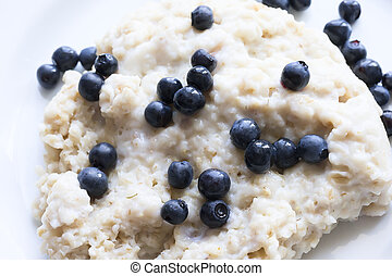 Oatmeal porridge with blueberry closeup