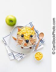 Oatmeal porridge with cute funny face, kids breakfast