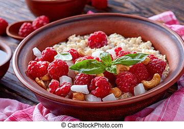 oatmeal porridge with fresh ripe raspberries