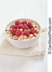 Oatmeal porridge with raspberries