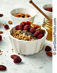 Oatmeal porridge with raspberry and figs in a bowl