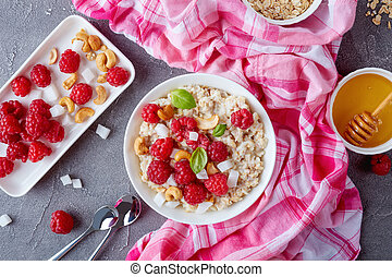 oatmeal porridge with raspberry, flat lay