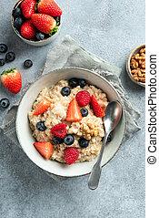 Oatmeal porridge with summer berries top view
